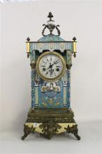 A FRENCH MANTEL CLOCK, enamel and gilt case on scroll feet, the enamel dial surmounted by a hand painted urn, two train movement, vi...