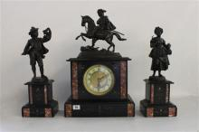 A MANTEL CLOCK, the architectural clock case with marble inlay, on plinth base, surmounted by a man on horseback, embellished with t...