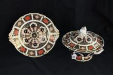 A ROYAL CROWN DERBY SOUP BOWL and saucer, numbered 1128 LI.