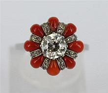 AN ART DECO CORAL AND DIAMOND CLUSTER RING, floral style cluster, central old mine cut diamond of approx 0.70cts surrounded by coral...