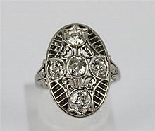 AN ART DECO DIAMOND RING, oval pierced plaque set with old cut diamonds totalling approx 1.00cts, scrolled shoulders; platinum. Ring...