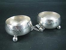 A PAIR OF VICTORIAN SILVER SALTS, each circular, Japonaiserie engraved flora and fauna; Martin, Hall & Co., Sheffield 1879. Total we...