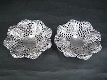 A PAIR OF EDWARDIAN SILVER SWEETMEAT DISHES, pierced and 'embossed'; retailed by Bechtler, Allahabad; James Dixon, Sheffield 1904. T.