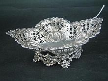 A VICTORIAN SILVER SWEETMEAT BOWL, shaped oval on cast foliate foot-ring, pierced and 'embossed'; James Dixon, Sheffield 1897. Weigh.