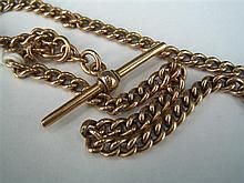 *A 9ct GOLD CURB-LINK ALBERT with 'T'-bar and swivel. Weight 25.6g.