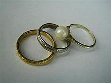 *AN 18ct WHITE GOLD BAND RING (2.8g), A CULTURED PEARL AND 9ct GOLD RING (2.2g), AND A METAL BAND RING. (3)