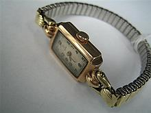 *A LADY'S TUDOR 9ct GOLD WRIST-WATCH.
