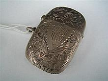 A VICTORIAN SILVER MATCH CASE engraved with scrolls and with monogrammed cartouche; Chester 1898.