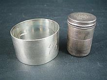 AN AUSTRALIAN SILVER MATCH CYLINDER, Mole (Queensland), AND A SERVIETTE RING. (2)
