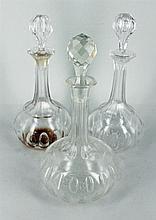 A PAIR OF CRYSTAL DECANTERS, thumb cut, AND ANOTHER DECANTER. (3)