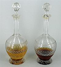 A PAIR OF CRYSTAL DECANTERS, etched and diamond cut. Height 33cm.
