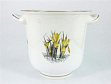 A ROYAL WORCESTER CACHE-POT, double handled, gilt rim and foot. Height 18cm.