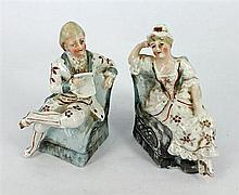 A PAIR OF CONTINENTAL PORCELAIN FIGURES, 'Lady and Gentleman' reclining. Height 12cm.