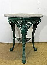 A CAST IRON PUB TABLE, 'Britannia' pattern, with round stone top. Diameter 69cm.
