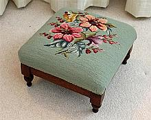 AN AUSTRALIAN COLONIAL CEDAR FOOTSTOOL, with foliate wool needlework top. Width 37cm.