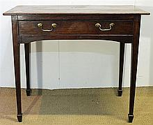 AN 18th CENTURY PROVINCIAL OAK SIDE TABLE with a frieze drawer with brass bale handles; on square-section tapered legs with spade fe...