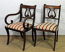 EIGHT REGENCY STYLE MAHOGANY LYREBACK DINING CHAIRS comprising six side chairs and a pair of carver chairs.