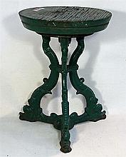 AN ENGLISH CAST IRON FERRY STOOL with circular top and triform base. Height 42cm. Diameter 30cm.