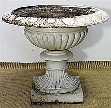A VICTORIAN CAST IRON GARDEN URN, half-fluted and with egg and dart rim. Diameter 60cm.