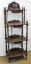 A VICTORIAN BURR WALNUT AND INLAID WHATNOT with mirror panel back, fret-pierced panels and turned supports. Width 55cm.