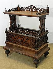 A VICTORIAN BURR WALNUT AND INLAID MUSIC CANTERBURY, with fret-pierced three-quarter gallery; fitted with a blind drawer to the base...