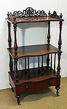 A VICTORIAN BURR WALNUT AND INLAID MUSIC CANTERBURY, with fret-pierced three-quarter gallery; fitted with a serpentine drawer with t...