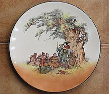 A ROYAL DOULTON SERIES-WARE CHARGER, 'Under the Greenwood Tree'. Diameter 34cm.