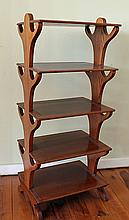 AN AUSTRALIAN COLONIAL CEDAR FIVE-TIER WHATNOT with rectangular shelves and shaped supports. Width 43cm.