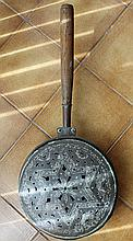 A 19th CENTURY COPPER WARMING PAN with turned oak handle. Pan diameter 30cm.