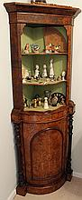 A VICTORIAN BURR WALNUT CORNER CABINET, bow fronted, with open shelves; the base with detached side columns. Height 172cm.