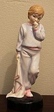A ROYAL DOULTON CHINA FIGURE 'Sleepy Darling'; HN2953. Height 18.5cm.