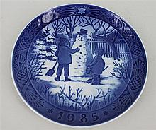 FOURTEEN ROYAL COPENHAGEN CHRISTMAS PLATES including a series 1979-1990 and a larger plate. Diameter 18.5cm and 24cm. (15)