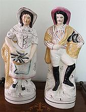 A PAIR OF 19th CENTURY STAFFORDSHIRE POTTERY FIGURES. Height 35cm.