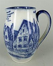 A ROYAL DOULTON BLUE & WHITE JUG 'Souvenir of the Roebuck Inn, Knebworth'. Height 20cm.