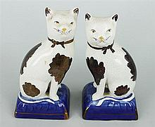 A PAIR OF STAFFORDSHIRE POTTERY CATS. Height 18.5cm.