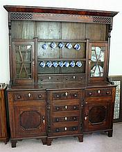 A 19th CENTURY OAK AND MAHOGANY CAERNARFONSHIRE DRESSER, with pierced cornice above open shelves and glazed cupboards, the breakfron...