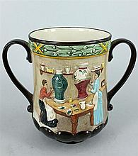 A ROYAL DOULTON COMMEMORATIVE LOVING CUP 'Pottery in the Past'. Height 16cm.