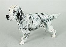 A ROYAL DOULTON CHINA SETTER.