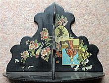 A 19th CENTURY JAPANNED WALL SHELF. Width 25cm.