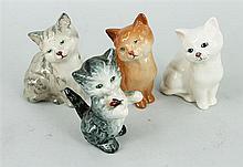 FOUR CHINA CATS, three Royal Doulton, one Goebel. (4)