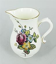 A ROYAL WORCESTER CHINA CREAM JUG, with maskhead beak spout. Height 10cm.