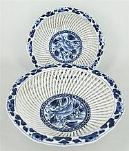 A PAIR OF CHINESE UNDERGLAZE BLUE & WHITE RETICULATED BASKETS. Diameter 21cm.