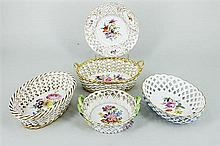 FIVE GERMAN PORCELAIN RETICULATED BASKETS, three Meissen. Lengths to 14cm.