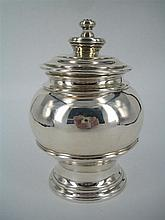A GEORGE I STYLE SILVER TEA CADDY of baluster form with close-fitted cover; C & R Comyns, London 1917. Height 13cm. Weight 265g.