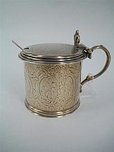 A VICTORIAN SILVER MUSTARD POT, with shallow domed hinged cover and shell thumb-piece; engraved with flower, leaf and lattice; Henry...