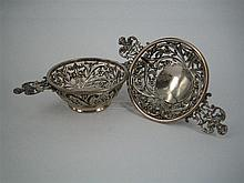 A PAIR OF VICTORIAN SILVER DISHES, each in the form of a quaiche, pierced and with maskhead flat handles; Sibray, Hall & Co., London...