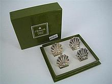 TWELVE CHRISTOFLE SILVER-PLATE PLACE-CARD HOLDERS; shell form. (boxed)