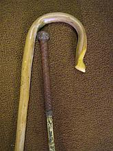 A SHEPHERD'S CROOK AND A CARRIAGE CROP. (2)