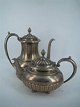 A SUBSTANTIAL MEXICAN SILVER TEA AND COFFEE SET, teapot, coffee pot, covered sugar basin and milk jug, each piece oval, half-fluted....