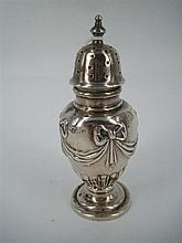 AN EDWARDIAN SILVER PEPPERETTE, half-fluted and embossed with swags and bows; Elkington, Birmingham 1905. Height 10cm.
